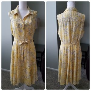 Dip sleveless button front yellow floral dress. Ti